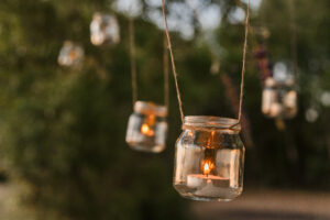 Waxine lichtje in glazen potje