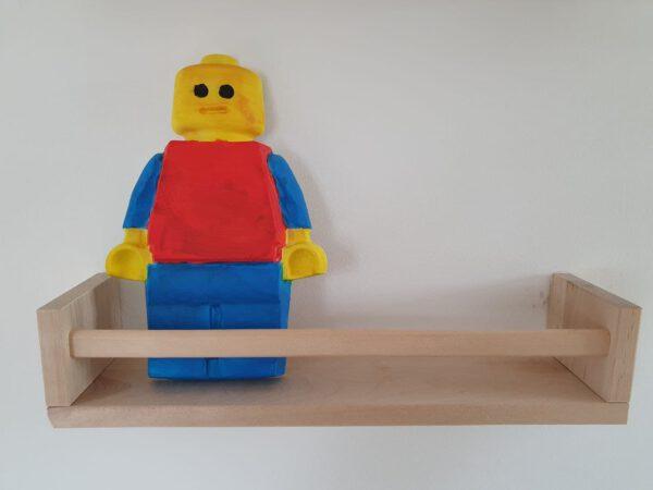 Lego pop van gips op plankje